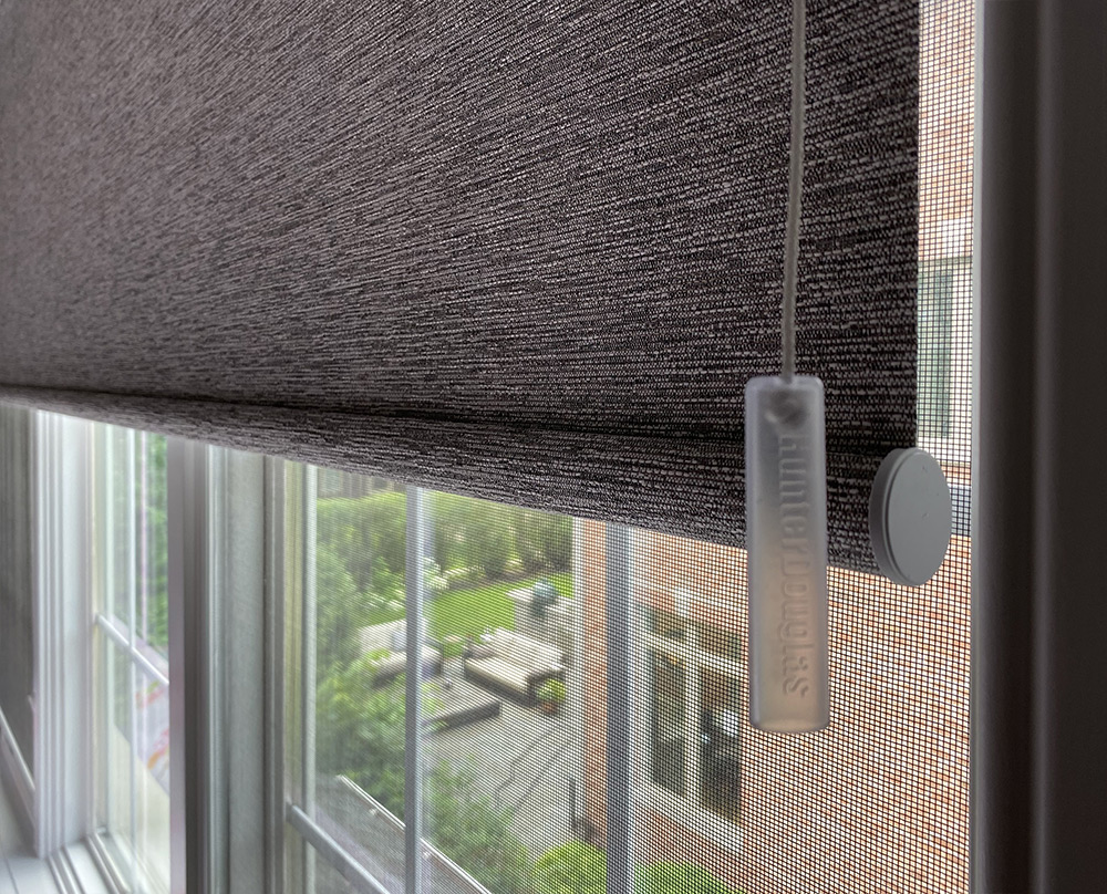 close up of window with brown textured roller shades Chicago IL