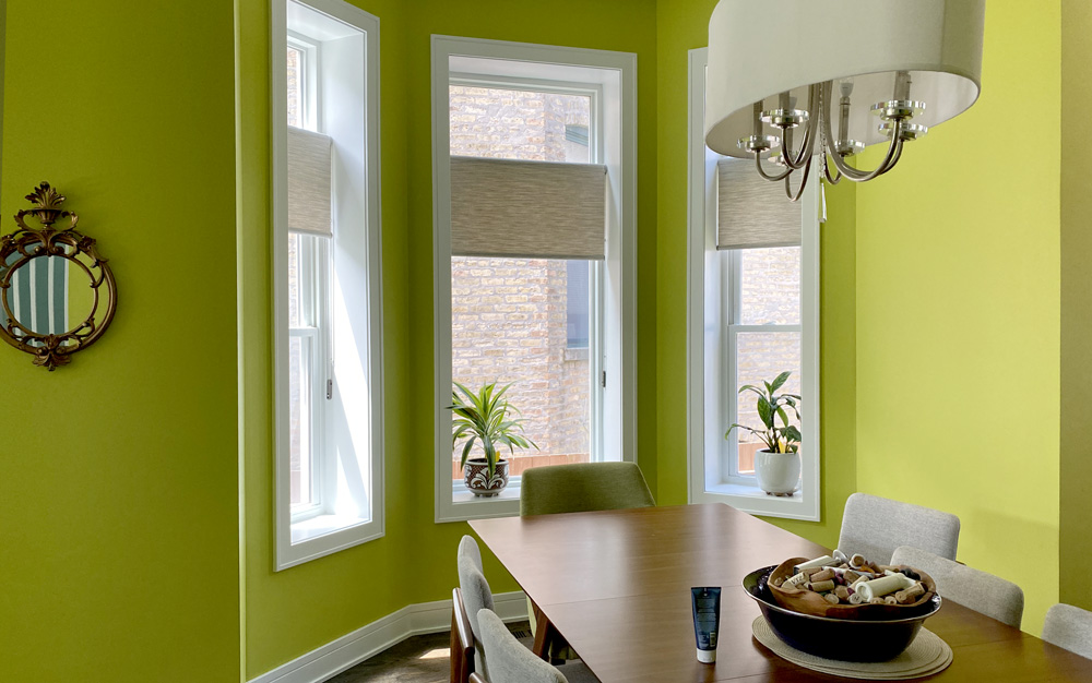 lime green walls with beige honeycomb shades on bay window nook in Chicago IL