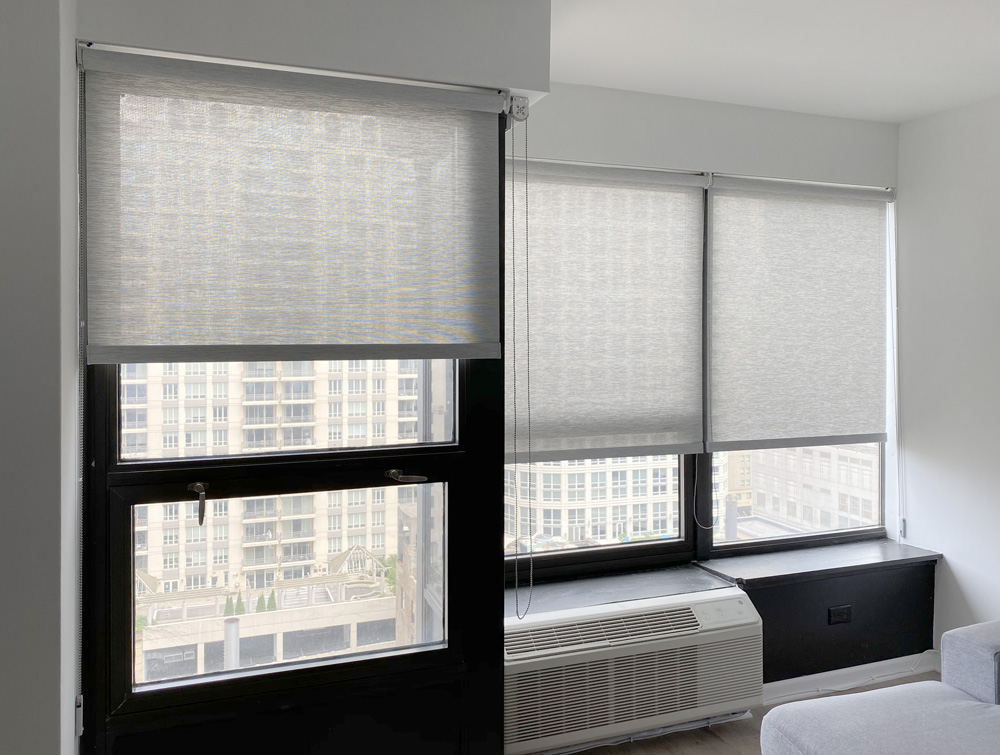 textured gray roller shades on black frames in Chicago 60614