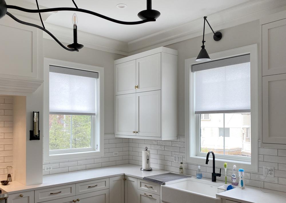 modern gray roller shades in white kitchen in Chicago IL