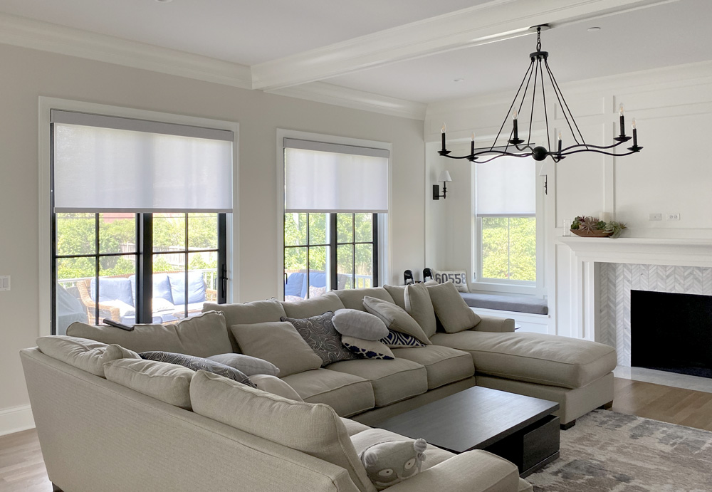 living room with light gray roller shades on black frame windows in Hinsdale IL