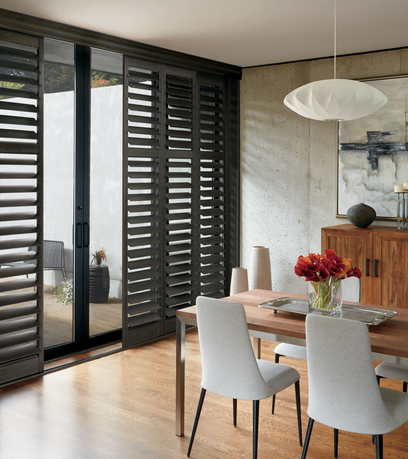 black shutters on sliding glass doors in Chicago IL dining room