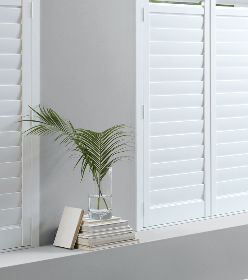 white plantation shutters on windows in Portland OR home