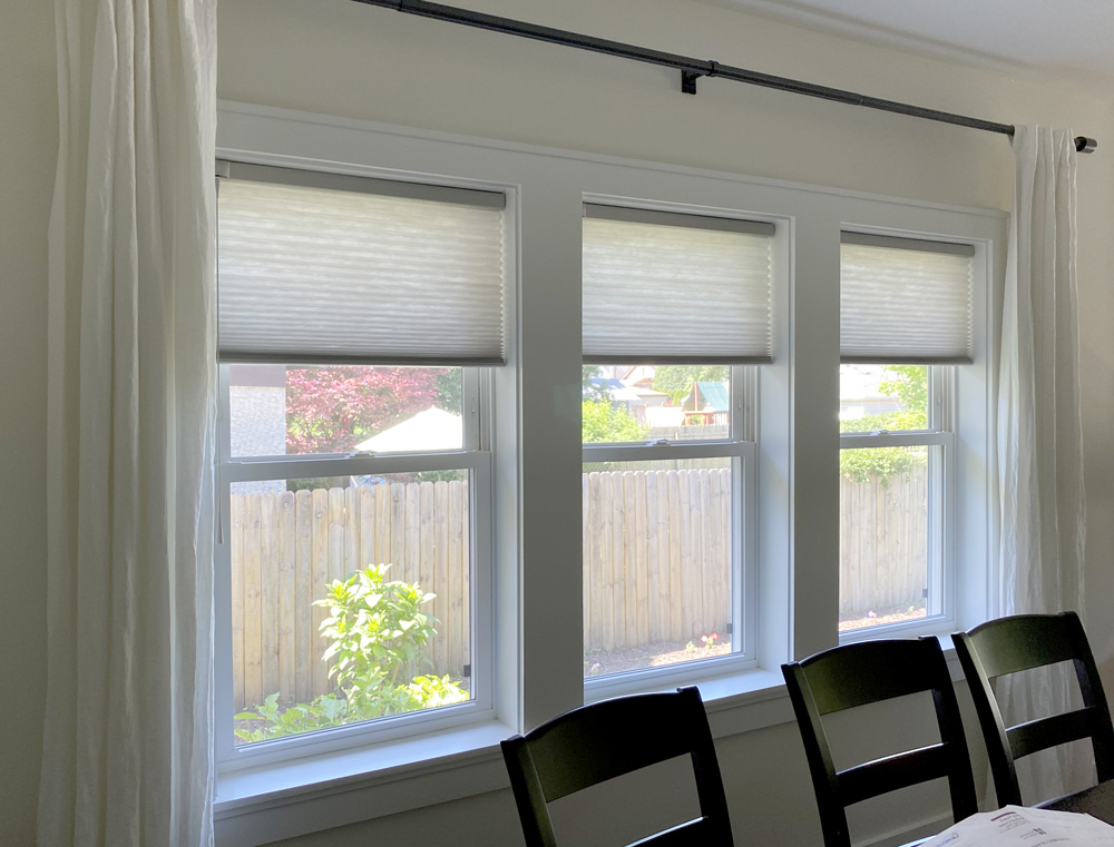 cellular shades in dining room with drapery side panels in Hinsdale IL