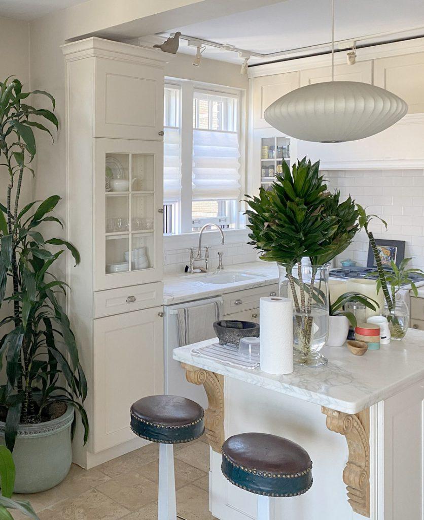 white roman shades above kitchen sink in Chicago 60657
