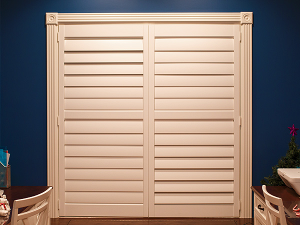 closed white shutter doors inset on a dark blue wall in Naperville IL