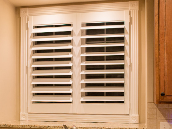 kitchen window with interior shutters in view through position in Naperville IL