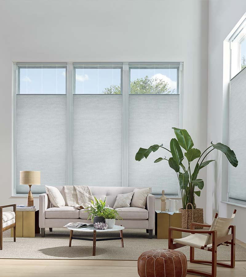 white living room with gray top lowering window treatments in Vancouver WA