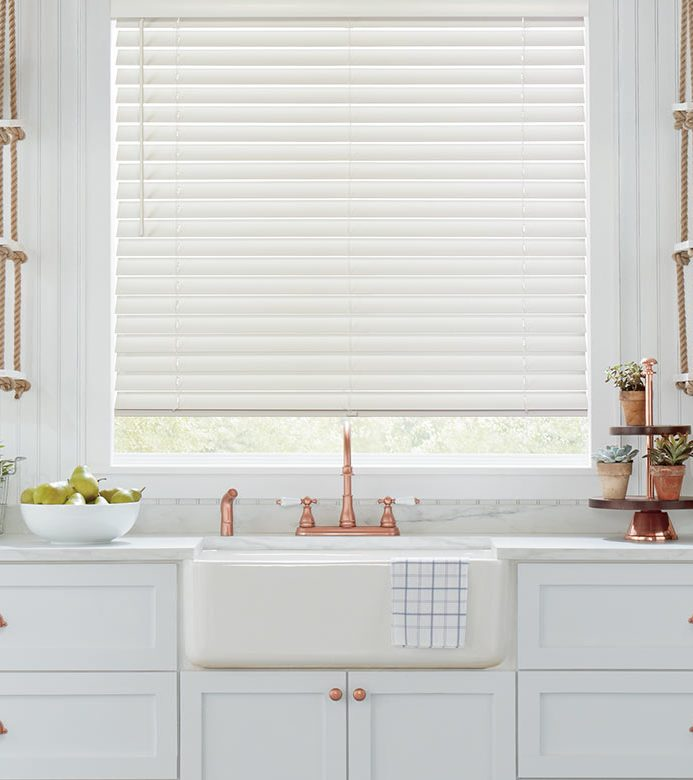 white kitchen with rose gold accents and over the sink window blinds Chicago, IL 60618