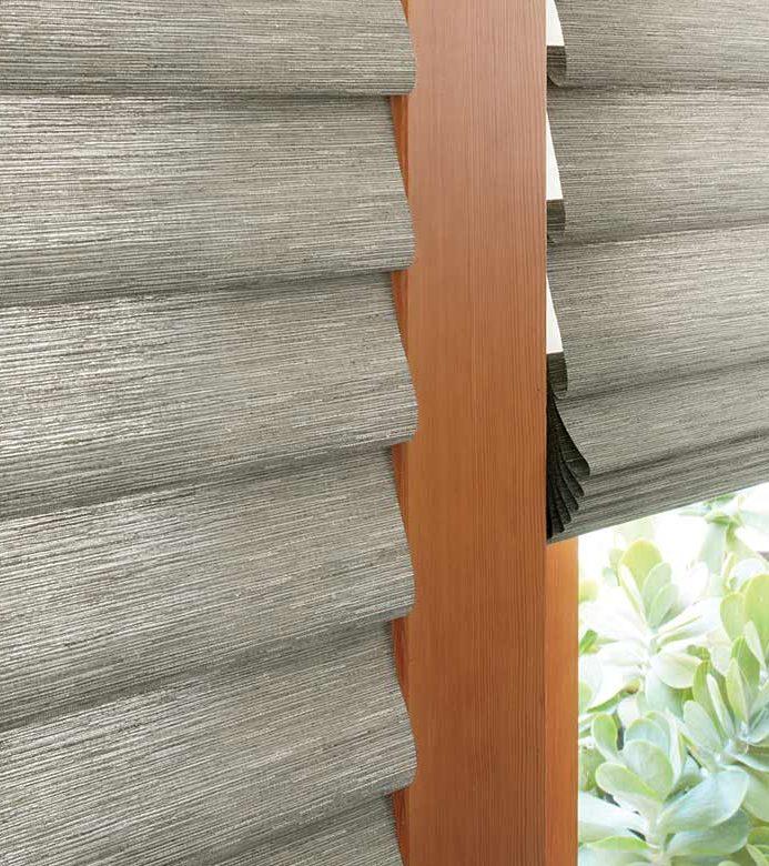 gray roman shades on glass patio doors