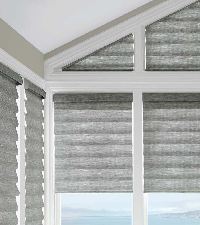 gray shades in corner window framed by white wood beams