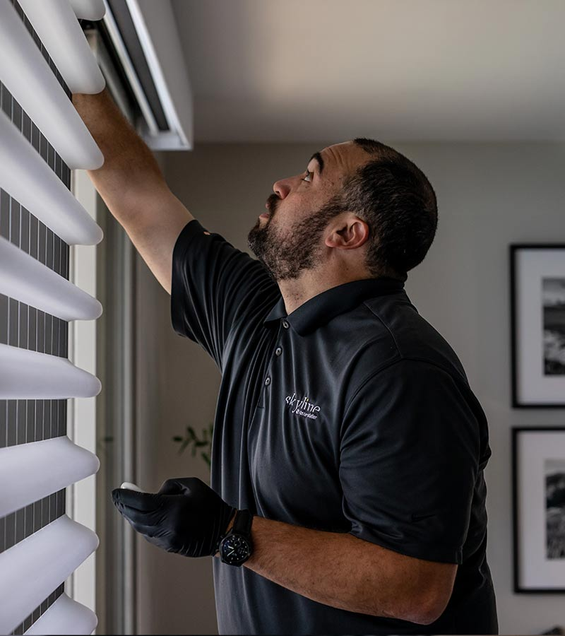 window treatment installer working on pirouette shades in Chicago, IL